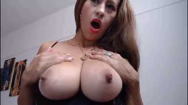 Lactating MILF Squeezes Her Engorged Breasts